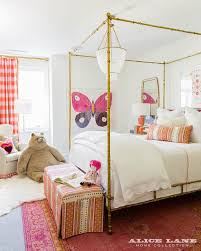 gold leaf canopy bed with pink and red rug