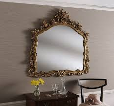 large gold wall mirror with decorative leaf frame 122 x 114 cm