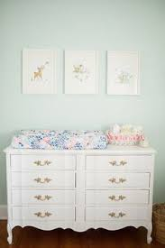nursery with white furniture. pastel color on walls white furniture vintage art and tiny floral print linens nursery with t