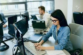 high quality office work. Beautiful Female Programmer Working Looking At Monitor, Typing Data Code In Company Office. High Quality Image. Office Work