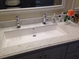 large white sin adn wooden sinks undermount trough sink bathroom sink boy bathroom guest bathroom double faucets porcelain table and