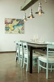 minimal coastal dining room with painted cote chairs and brushed green wood beams and light fixture
