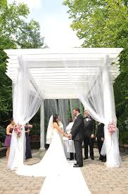 Tulle Fabric Wedding Decorations Gazebo As Outdoor Chuppah Draped With White Tulle And Pink Flowers