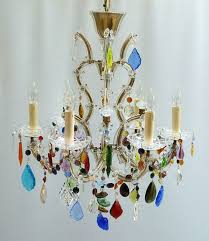 this is a beautiful cage shape marie therese frame with glass prisms and array of eclectic multi coloured drops and swags