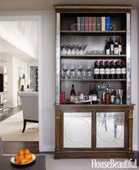 best home bar designs. change your bookcase into a boozecase with this cool at home bar design. books and bottles are comparable in size, making library shelves great pieces of best designs