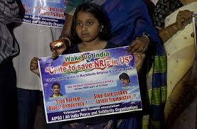 a hate crime exposes deeper rifts between asian americans essay  a girl holds a placard as she joins parents of ns living abroad and others in a candlelight vigil to pay tribute to srinivas kuchibhotla in hyderabad