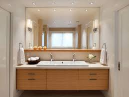 sleek framed mirror using standard vanity height with white sink for small bathroom plan