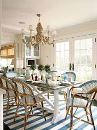 ashley whittaker design breakfast dining room south hton summer home farm table french bistro chairs blue white sea s six light chandelier french
