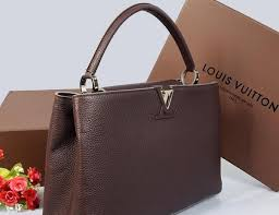 louis vuitton bags prices. louis vuitton decides to luxe up purses and prices lure deeper pockets bags