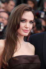 angelina jolie used her chocolate brown dress as inspiration for her subtly smoky eye makeup
