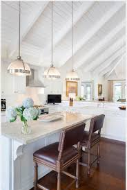 three white half ball pendant lights hang from a tall vaulted pendant light vaulted ceiling simple