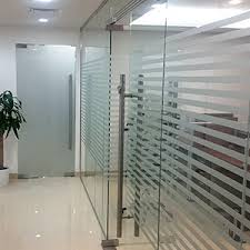 glass partition dubai with decorative film and frameless doors office partitions a30
