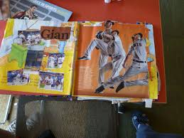 there are pictures along with words depicting sports agents and their affect on consumerism in sports the altered book page is within my altered book