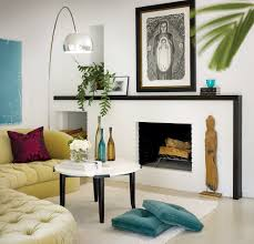 black fireplace mantel living room eclectic with art above