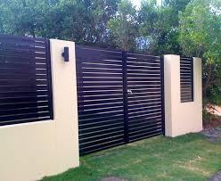 front garden walls and gates. double gates in a front fence. garden walls and
