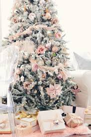 We're dreaming of a pink Christmas! Add a feather garland to a tree