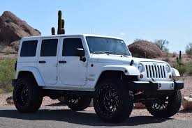2012 jeep wrangler unlimited lifted unlimited sahara with 6000 in suspension wheels tires
