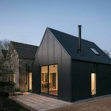 earook architects adds corrugated metal extension to cotswolds cottage