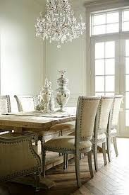 chic modern french dining room design with rustic wood trestle dining table gray french oly studio sarah dining chairs upholstered in tan linen with