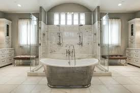 beautiful master bathroom with large shower cast iron bathtub and marble floors