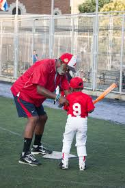 harlem home run upper inner city league photo essay olivia lace kelvin mcallister helps david aberdeen junior a member of the little tigers position his