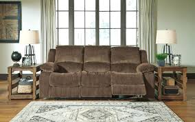 ashley reclining sofa linebacker reviews with massage signature design by acieona drop down table in slate