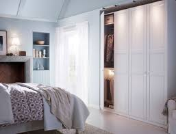 ikea bed furniture. a white bedroom with large wardrobe combination and bed textiles in ikea furniture
