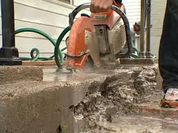 concrete saw used to remove damaged portion of concrete step