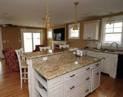 lovely kitchen design with white vetrazzo countertops plus pendant lamp and wooden floor