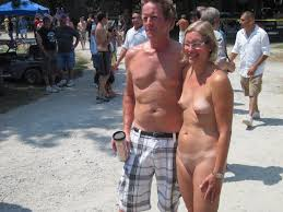 Naked woman clothed men