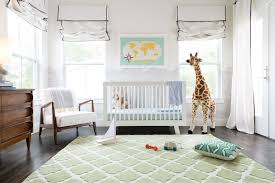 nursery with green quatrefoil rug