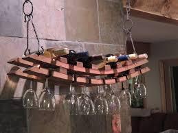 amazing unique design of hanging wine glass rack with granite stone wall kitchen decor