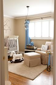 here is a peek into the nursery from the door the rooms calming neutral palette of beige brown and white is accented with pops of baby boy blue baby nursery cool bee