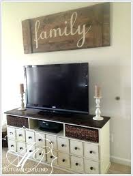 wall decor above tv large sign to fill up space behind the wall decor ideas behind wall decor above tv