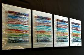 4 piece glass wall art panels in fused glass and brushed aluminum