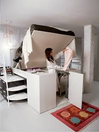 Container Bed by Dielle Raises the Bar on Built-In Bed Storage. Bed lifts  up to access under bed storage area.