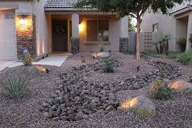 Low Maintenance Front Yard Landscaping | Front yard desert landscape design  with rock, river bed