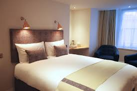 above bed lighting. Wall Lights Used As Reading Lamps Above Beds In Domestic Lighting Scheme Bed E