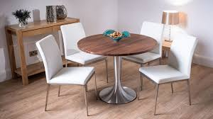 round dining table and white dining chairs
