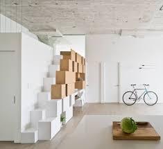 Creative Storage Creative Storage Wall Incorporates Stairwell To New Mezzanine