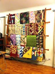 quilt rack with shelves hanging shelf wall racks do you have one hanger curtain holder mounted