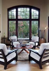 round area rugs with traditional living room and arch window seat cushions beige round area rug wood floor