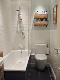 bathroom over the toilet cabinet white marble features alcove bathtub cylinder glass bottle full flush