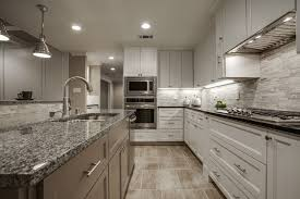 luxury galley kitchen with a contemporary style and brown island with white base cabinets