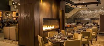 prospect s restaurant with table and chairs near fireplace