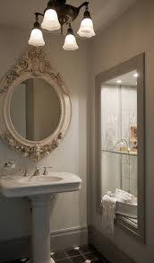 In the bathroom, a stunning composition between the framed shelves, mirror  and pedestal sink