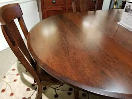 close up of the brookfield solid cherry table top in a bourbon stain