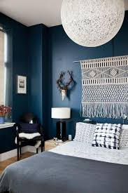 fresh bohemian layers over dark paint create a high contrast bedroom via coco
