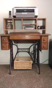 singer sewing machine turned into computer desk