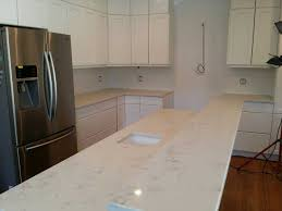 carrara grigio quartz countertop with white cabinet in oak park il